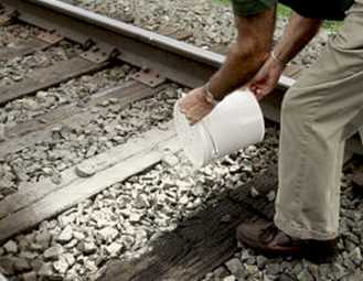 Manual application on Railroad tracks.